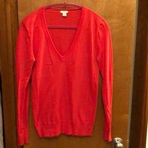 JCrew bright salmon colored v-neck sweater.